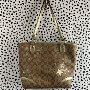 Tan and gold star coach long handled purse